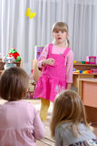 Preschoolers. Preschooler girl speech in kindergarten Stock Photography