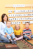 Preschoolers. Teacher and three preschoolers during lesson Stock Photography