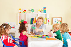 Preschoolers in the classroom. Preschool children in the classroom with the teacher Royalty Free Stock Images