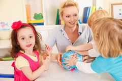 Preschoolers in the classroom with teacher royalty free stock photos