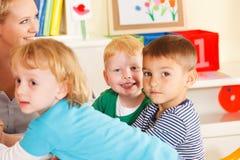 Preschoolers in the classroom with teacher stock photo