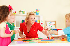 Preschoolers in the classroom with the teacher Royalty Free Stock Image