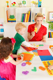 Preschoolers in the classroom with the teacher Stock Images