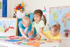 Preschoolers in the classroom. Three preschoolers in the classroom Stock Photo
