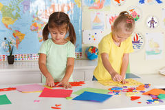 Preschoolers in the classroom. Two little girls in the classroom Stock Photography