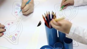 Preschoolers drawing at kindergarten stock video