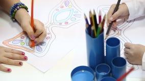 Preschoolers drawing at kindergarten stock video footage