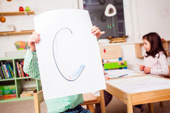 Preschoolers learn letters Royalty Free Stock Photos