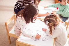 Preschoolers learn letters Stock Images