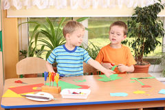 Preschoolers and manual skills. Two preschoolers making some decoration Royalty Free Stock Photography