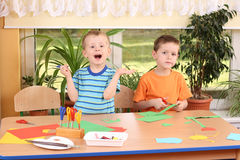 Preschoolers and manual skills. Two preschoolers making some decoration Royalty Free Stock Image