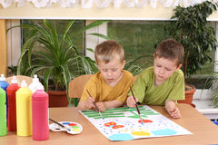 Preschoolers and painting. Two preschoolers and colorful painting - education Royalty Free Stock Photos