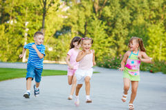 Preschoolers running Stock Images