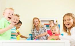 Preschoolers with teacher Stock Images