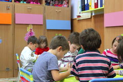 Preschoolers to kindergarten. Preschool children in the kindergarten classroom activities at a kindergarten in Bucharest, Romania Stock Photography