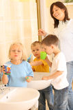 Preschoolers and white teeth. Preschoolers in bathroom ready to clean teeth Stock Images