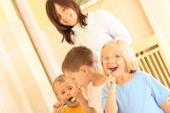 Preschoolers and white teeth. Preschoolers in bathroom washing hands Stock Photos