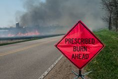 Prescribed Agricultural Burn Area and Sign stock photo
