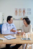 Prescribing Drugs to Patient Stock Image
