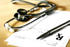 Prescription. Doctor's medical prescription and stethoscope Royalty Free Stock Photography