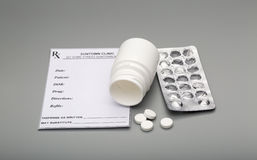 Prescription blank and open pill bottle Stock Photo