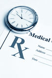 Prescription and clock Royalty Free Stock Image