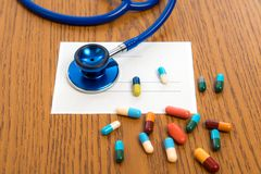 Prescription with colorful pills and stethoscope Royalty Free Stock Photos
