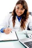 Prescription de sourire d'écriture de docteur Photographie stock libre de droits
