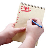 Prescription diet. Hands hold a notepad and a pen to write a prescription diet Stock Images