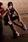 Prescription drug abuse. Young men offering prescription drugs stock photography