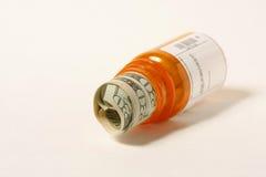 Prescription Drug Costs. Money in a prescription bottle Stock Images