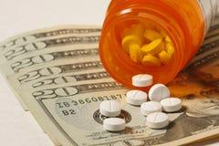 Prescription Drug Costs. Prescription Drugs on twenty dollar bills Royalty Free Stock Image