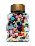 Prescription drugs abuse assorted pills bottle jar. Glass jar filled with mixed pills, tablets and capsules isolated on white Royalty Free Stock Image