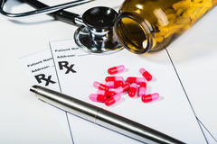 Prescription drugs overvoltage by a doctor. Stock Photo