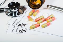 Prescription drugs overvoltage by a doctor. Royalty Free Stock Photography