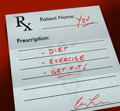 Prescription Form - Get Fit. A paper prescription form with a doctor's handwriting that reads - Diet, Exercise, Get Fit Royalty Free Stock Photo