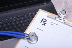 Prescription form with laptop computer and stethoscope Royalty Free Stock Photos