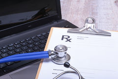 Prescription form with laptop computer and stethoscope Royalty Free Stock Image