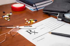 Prescription form with pills, pen, glasses  and stethoscope Royalty Free Stock Photography