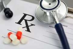 Prescription lying on clipboard pad with stethoscope Royalty Free Stock Photo