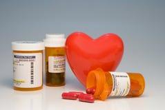 Prescription Medication. A heart and bottles of prescription medication Royalty Free Stock Photography