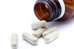 Prescription Medication Bottle Spilling capsules Royalty Free Stock Images