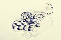 Prescription Medication Pills spilled out of Glass Drug Bottle o Stock Photo