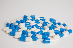 Prescription medicine blue and white capsules Royalty Free Stock Photography