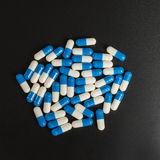 Prescription medicine blue and white capsules Stock Photo