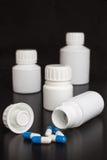 Prescription medicine blue and white capsules Stock Images