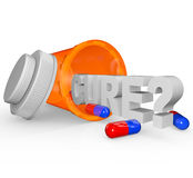 Prescription Medicine Bottle - Cure Word. An open prescription medicine bottle on its side and spilled, with the word Cure and question mark royalty free illustration