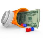Prescription Medicine Bottle - Money Inside. An open prescription medicine bottle on its side and spilled, with hundred dollar bills inside it Stock Photography