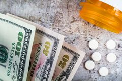 Prescription medicine on dollars for pharmaceutical industry concept. Of high cost for healthcare and medication, closeup macro royalty free stock photo
