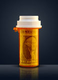 Prescription for money. Prescription bottle with dollar bill inside royalty free stock images